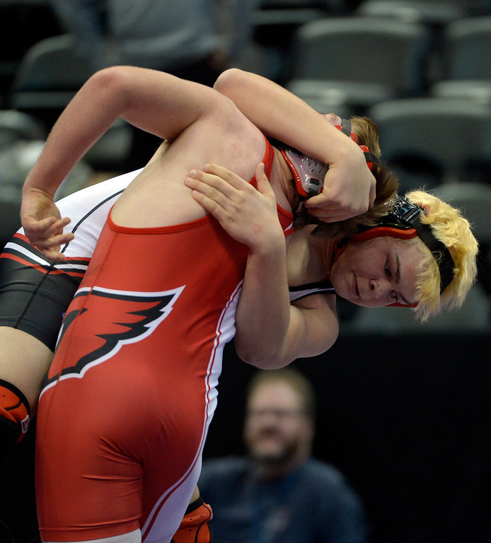 . DENVER, CO - FEBRUARY 20: Jon Satterly of Burlington, top, pulls down Sam Cox of McClave during Class 2A 220 pound action on the first day of Colorado High School State Wrestling February 20, 2014 Pepsi Center. Satterly defeated Cox by pin.  (Photo by John Leyba/The Denver Post)