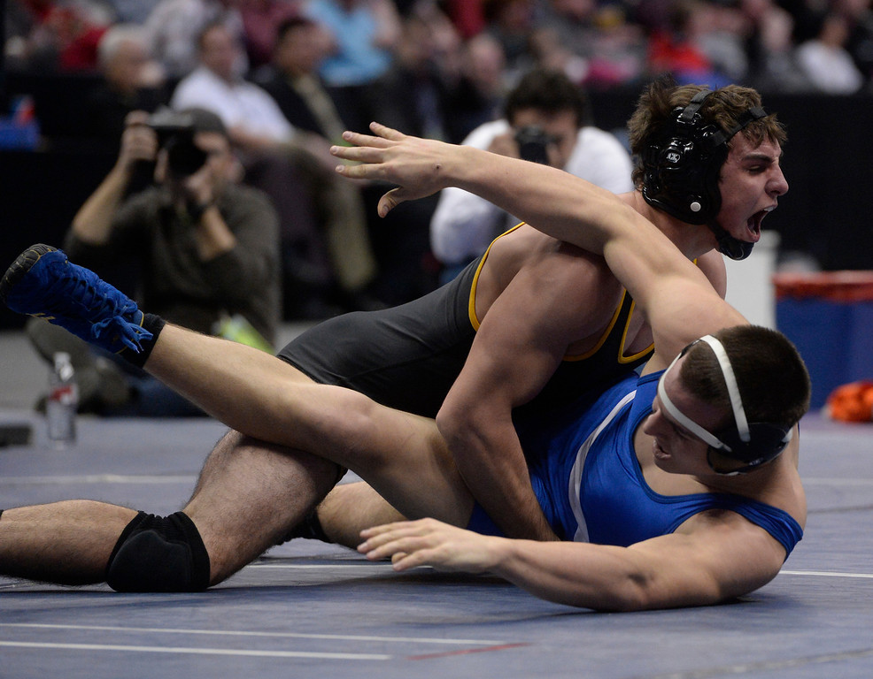 . DENVER, CO - FEBRUARY 22: T.J. Shelton of Meeker wrestles Jon Hickman of Lyons in the 2A 170lb. championship match. The Colorado Wrestling Tournament was held at the Pepsi Center in Denver, Colo. on February 22, 2014. (Photo by Andy Cross/The Denver Post)
