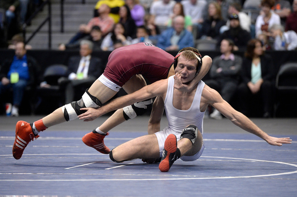 . DENVER, CO - FEBRUARY 22: Jesse Reead of Paonia (in white) wrestles Austin Coy of Swink (in maroon) in the 2A 126lb. championship match. The Colorado Wrestling Tournament was held at the Pepsi Center in Denver, Colo. on February 22, 2014. (Photo by Andy Cross/The Denver Post)