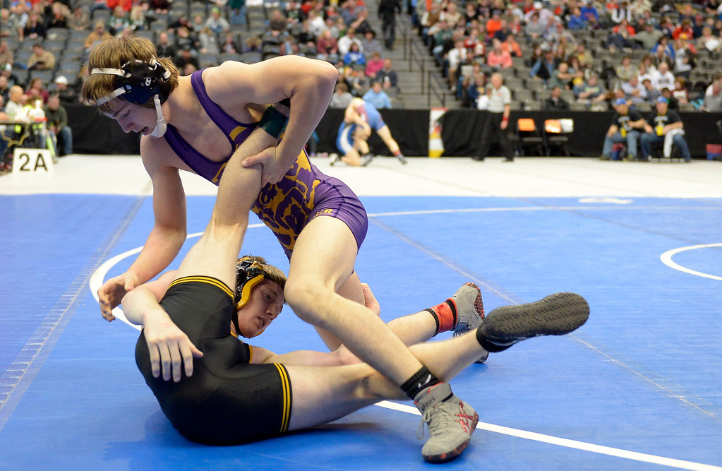 . DENVER, CO - FEBRUARY 20: Drew Corsentino of Fowler takes control of Aaron Cochran of Meeker during Class 2A 132 pounds on the first day of Colorado High School State Wrestling February 20, 2014 Pepsi Center. Corsentino defeated Cochran 6-4. (Photo by John Leyba/The Denver Post)