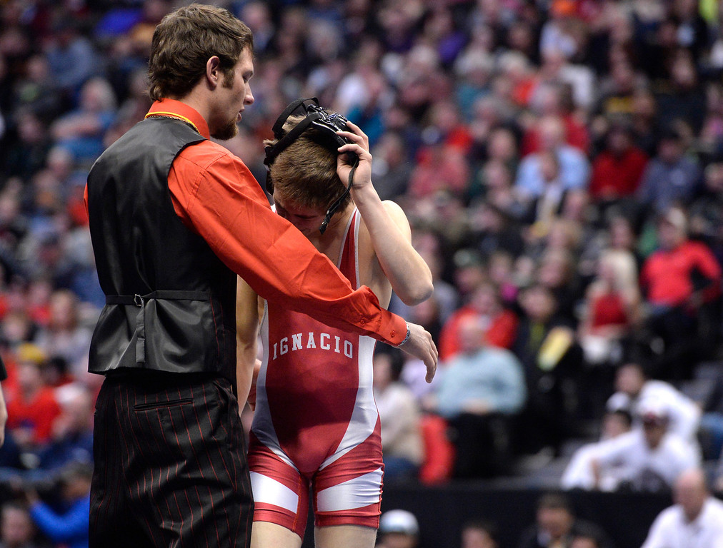 . DENVER, CO - FEBRUARY 22: Stocker Robbins is comforted by his coach after losing the 2A 106lb. championship match. The Colorado Wrestling Tournament was held at the Pepsi Center in Denver, Colo. on February 22, 2014. (Photo by Andy Cross/The Denver Post)