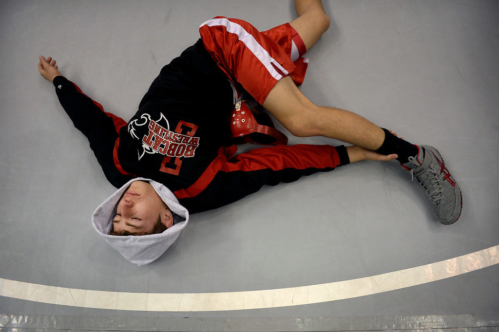 . DENVER, CO. - FEBRUARY 22: Freshman Ethan Appenzeller of Ignacio High School stretches out before his 2A 126-pound consolation match during the Colorado State Wrestling Championship at the Pepsi Center in Denver, CO February 22, 2014. (Photo By Craig F. Walker / The Denver Post)