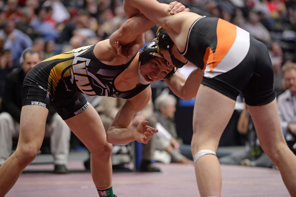 . DENVER, CO - FEBRUARY 22: Macoy Flanagan of Valley (in black and yellow) wrestles Joel Contreras of Sterling (in black and orange) in the 3A 145lb. championship match. The Colorado Wrestling Tournament was held at the Pepsi Center in Denver, Colo. on February 22, 2014. (Photo by Andy Cross/The Denver Post)