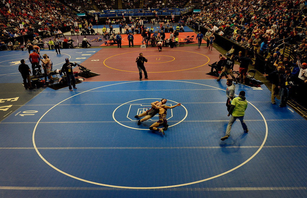 . DENVER, CO. - FEBRUARY 22: Senior Fabian Hermosillo, bottom, of Ellicott High School takes control of Andrew Register, of Classical Academy  during the Colorado State Wrestling Championship at the Pepsi Center in Denver, CO February 22, 2014. Hermosillo won the 3A 145-pound consolation match.  (Photo By Craig F. Walker / The Denver Post)