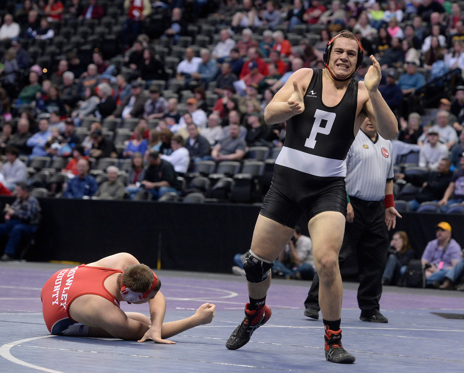. DENVER, CO - FEBRUARY 22: Devin Chacon of Centauri wrestles Creede Wylie of Pagosa Springs (in black)  in the 3A 285lb. championship match. The Colorado Wrestling Tournament was held at the Pepsi Center in Denver, Colo. on February 22, 2014. (Photo by Andy Cross/The Denver Post)