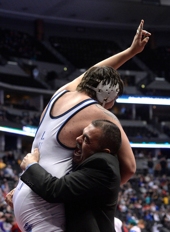 . DENVER, CO - FEBRUARY 22: Jacob Ornelas of Ft. Lupton defeats Joe Carwin in the 3A 220lb. championship match. The Colorado Wrestling Tournament was held at the Pepsi Center in Denver, Colo. on February 22, 2014. (Photo by Andy Cross/The Denver Post)