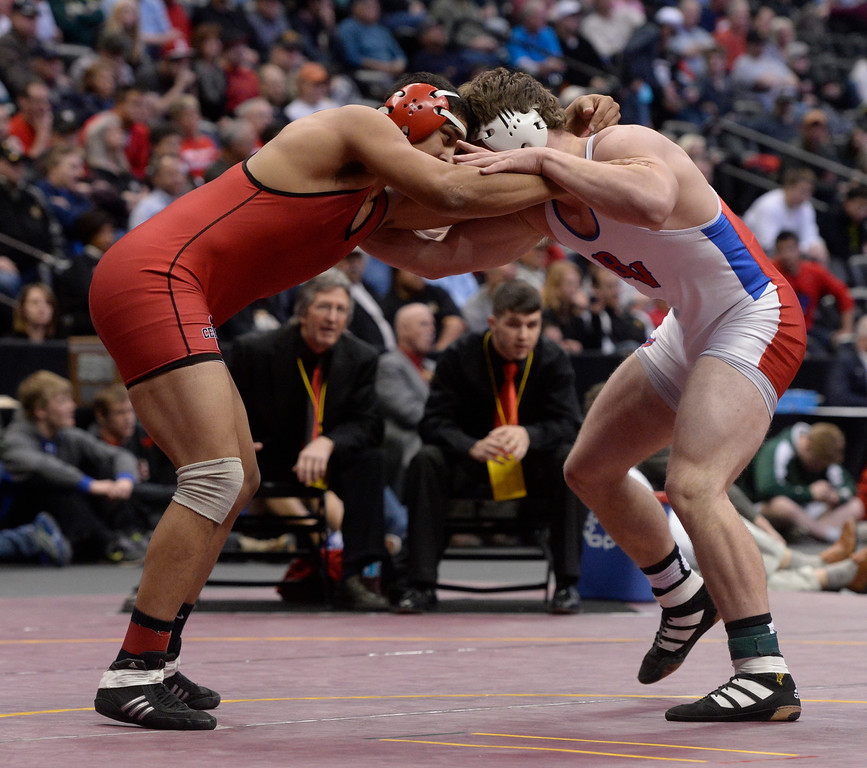 . DENVER, CO - FEBRUARY 22: Jareb Aziz of Centauri (in red) wrestles Keegan Wentz of Buena Vista (in white) in the 3A 195lb. championship match. The Colorado Wrestling Tournament was held at the Pepsi Center in Denver, Colo. on February 22, 2014. (Photo by Andy Cross/The Denver Post)
