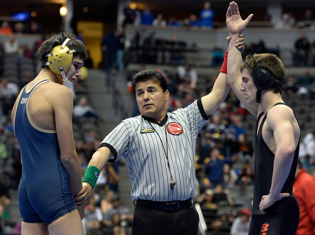 . DENVER, CO - FEBRUARY 21: Garrett Miller, right, from Bennett wins his match against Emmanuel Barba from Olathe in the 3A 126 pound class. The Colorado Wresting State Championships take place at the Pepsi Center with the quarterfinals taking place on Friday, Feb. 21, 2014. (Photo by Kathryn Scott Osler/The Denver Post)