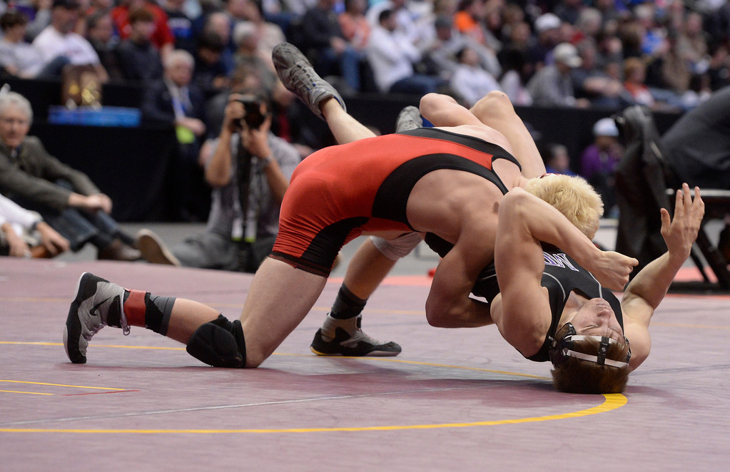 . DENVER, CO - FEBRUARY 22: Jason Buhr of Centauri (in red) wrestles Adam Visconti of Middle Park (in black) in the 3A 152lb. championship match. The Colorado Wrestling Tournament was held at the Pepsi Center in Denver, Colo. on February 22, 2014. (Photo by Andy Cross/The Denver Post)