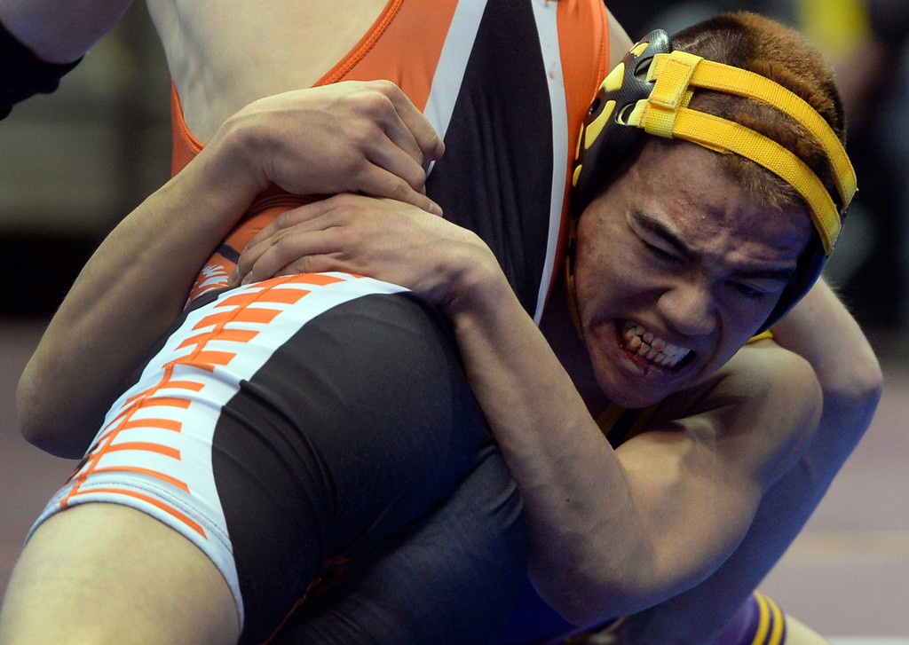 . DENVER, CO - FEBRUARY 21: Ryan Arguello, right, from Lake County wrestles Dax Bender from La Junta in the 3A 132 pound class. The Colorado Wresting State Championships take place at the Pepsi Center with the quarterfinals taking place on Friday, Feb. 21, 2014. (Photo by Kathryn Scott Osler/The Denver Post)