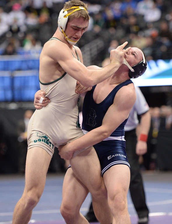 . DENVER, CO - FEBRUARY 22: Phil Downing of Broomfield (in blue) wrestles Keenan Willits of Pueblo county (in tan) in the 4A 160lb. championship match. The Colorado Wrestling Tournament was held at the Pepsi Center in Denver, Colo. on February 22, 2014. (Photo by Hyoung Chang/The Denver Post)