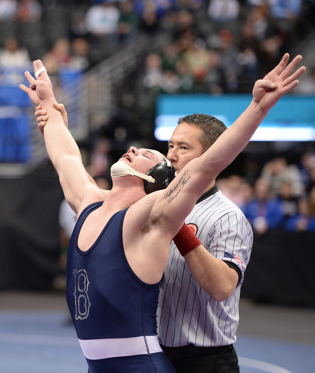 . DENVER, CO - FEBRUARY 22: Phil Downing celebrate his win in the 4A 160lb. championship match. The Colorado Wrestling Tournament was held at the Pepsi Center in Denver, Colo. on February 22, 2014. (Photo by Hyoung Chang/The Denver Post)