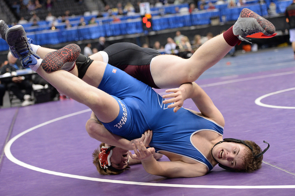 . DENVER, CO - FEBRUARY 22: Evan Lancelot of Pueblo Central (in blue) wrestles Toby McBride in the 4A 220lb. championship match. The Colorado Wrestling Tournament was held at the Pepsi Center in Denver, Colo. on February 22, 2014. (Photo by Hyoung Chang/The Denver Post)