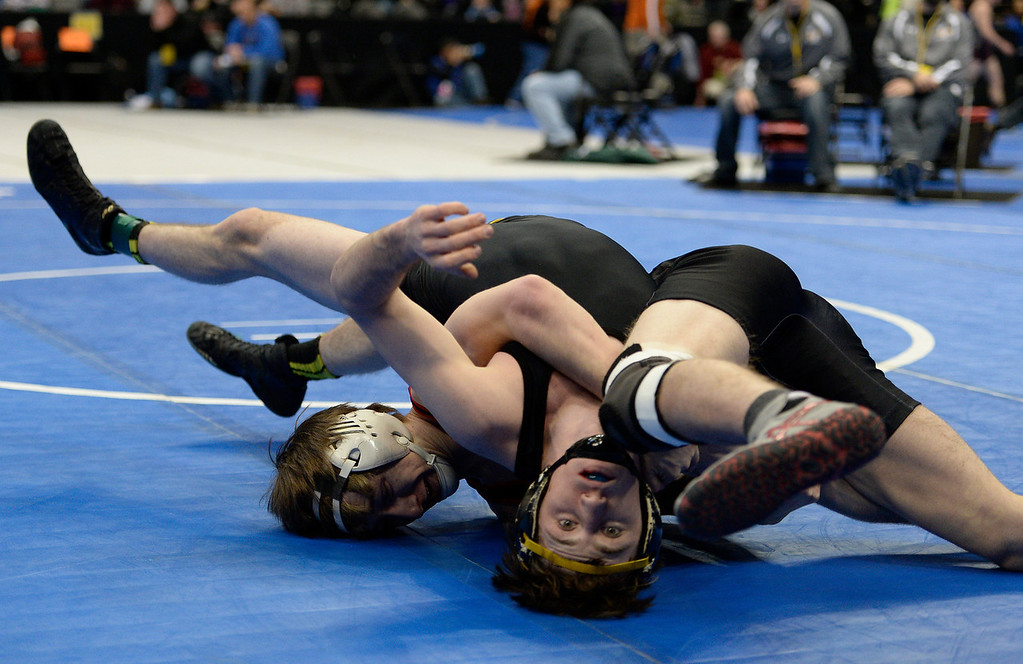 . DENVER, CO - FEBRUARY 20: Matt Sandoval of Montrose flips over Ben Hewson of Thompson Valley during their class 4A 138 pound match on the first day of Colorado High School State Wrestling February 20, 2014 Pepsi Center. (Photo by John Leyba/The Denver Post)