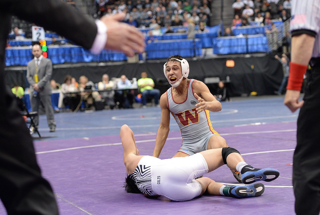 . DENVER, CO - FEBRUARY 22: Michael Ramirez of Pueblo South (in white) is defeated by Josh Villa of Windsor (in white, yellow and red) in the 4A 113lb. championship match. The Colorado Wrestling Tournament was held at the Pepsi Center in Denver, Colo. on February 22, 2014. (Photo by Hyoung Chang/The Denver Post)