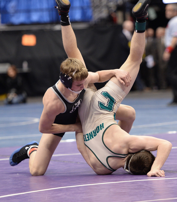 . DENVER, CO - FEBRUARY 22: Sam Turner of Discovery Canyon (in black) wrestles Chris Sandoval of Pueblo County (in tan and green) in the 4A 120lb. championship match. The Colorado Wrestling Tournament was held at the Pepsi Center in Denver, Colo. on February 22, 2014. (Photo by Hyoung Chang/The Denver Post)