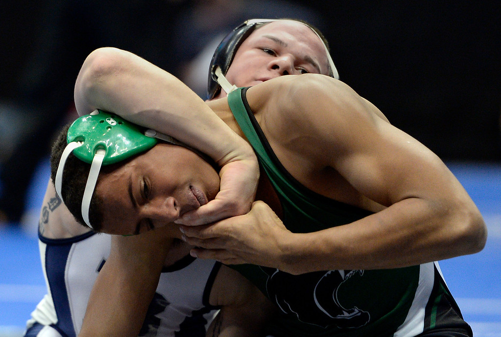 . DENVER, CO - FEBRUARY 20: Phil Downing of Broomfield puts a head lock on Jonathon Hinton of Woodland Park during their class 4A 160 pound match on the first day of Colorado High School State Wrestling February 20, 2014 Pepsi Center. Downing pinned Hinton in the first period. (Photo by John Leyba/The Denver Post)