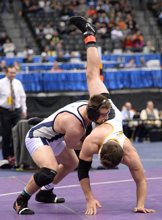 . DENVER, CO - FEBRUARY 22: Zach Stodden of Broomfield (in white and blue) and Phillip Benavidez of Pueblo East wrestle in the 4A 182lb. championship match. The Colorado Wrestling Tournament was held at the Pepsi Center in Denver, Colo. on February 22, 2014. (Photo by Hyoung Chang/The Denver Post)