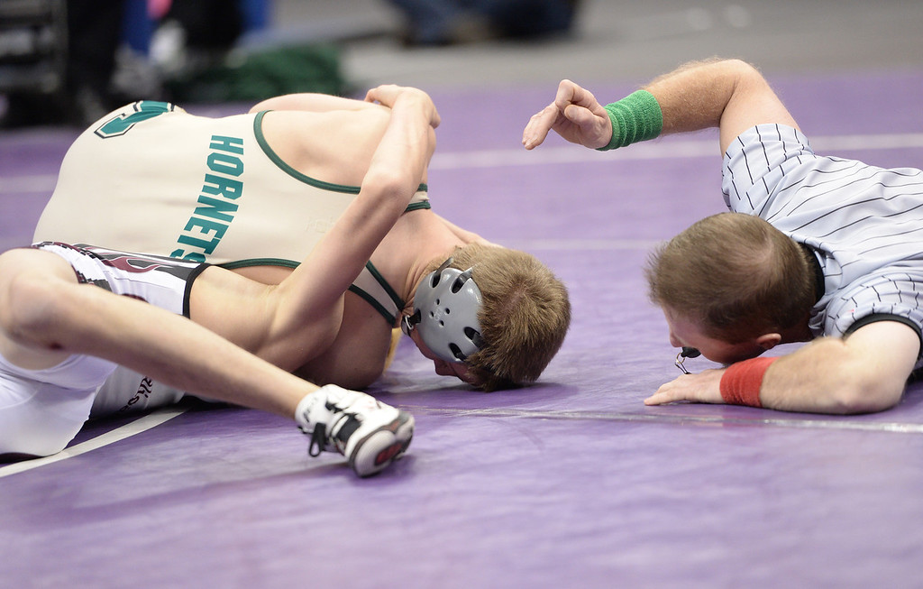. DENVER, CO - FEBRUARY 22: Grant Willits of Pueblo County (in tan) wrestles Randen Espinoza of Palisade (in white, black and maroon) in the 4A 106lb. championship match. The Colorado Wrestling Tournament was held at the Pepsi Center in Denver, Colo. on February 22, 2014. (Photo by Hyoung Chang/The Denver Post)