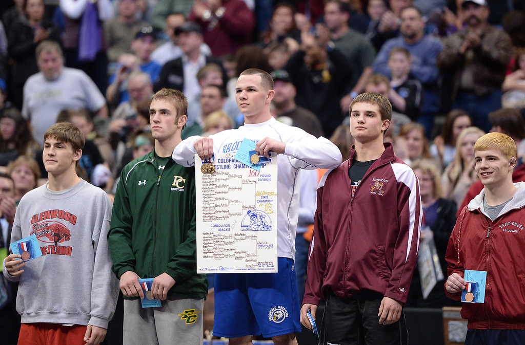 . DENVER, CO - FEBRUARY 22: Phil Downing holds up his medals as he wins his fourth state championship in the 4A 160lb. class. The Colorado Wrestling Tournament was held at the Pepsi Center in Denver, Colo. on February 22, 2014. (Photo by Hyoung Chang/The Denver Post)