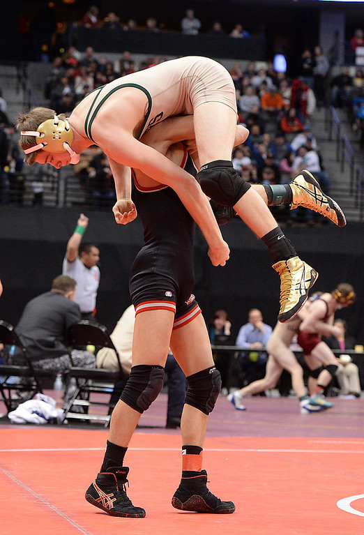 . DENVER, CO - FEBRUARY 22: Jose Rosales of Pomona (in black) wrestles Jaysen Yakobson of Bear Creek (in tan and green) in the 5A 120lb. championship match. The Colorado Wrestling Tournament was held at the Pepsi Center in Denver, Colo. on February 22, 2014. (Photo by Karl Gehring/The Denver Post)