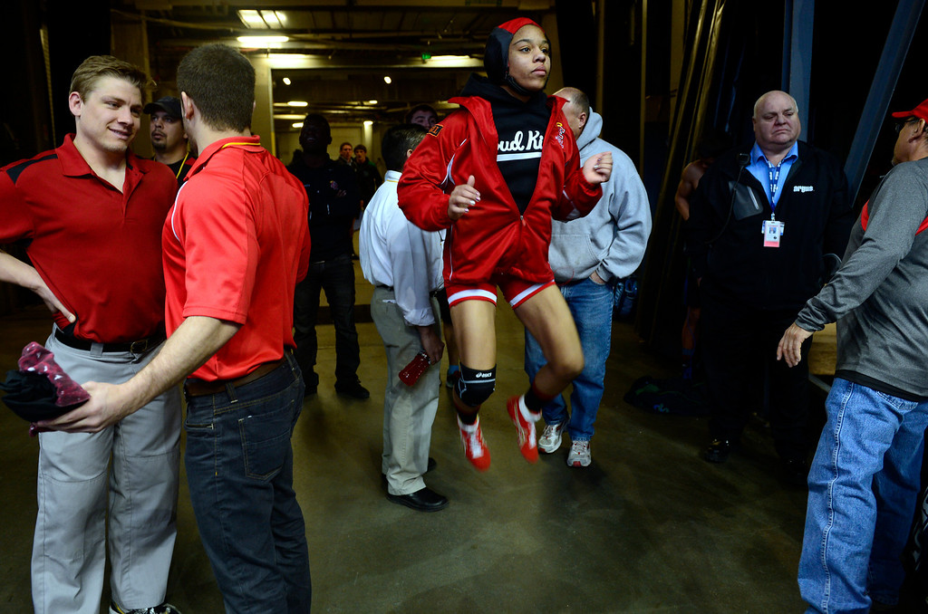 . DENVER, CO - FEBRUARY 21: Competing in 5A in the 120 pound class, Denver East\'s Maya Nelson warms up before her match. The Colorado Wresting State Championships take place at the Pepsi Center with the quarterfinals taking place on Friday, Feb. 21, 2014. (Photo by Kathryn Scott Osler/The Denver Post)