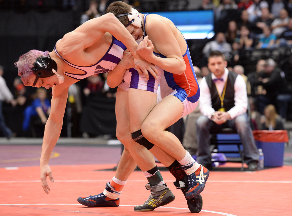 . DENVER, CO - FEBRUARY 22: Zach Finesilver of Cherry Creek (in white, red and blue) wrestles Jimmy Rothwell of Arvada West (in white and purple) in the 5A 138lb. championship match. The Colorado Wrestling Tournament was held at the Pepsi Center in Denver, Colo. on February 22, 2014. (Photo by Karl Gehring/The Denver Post)