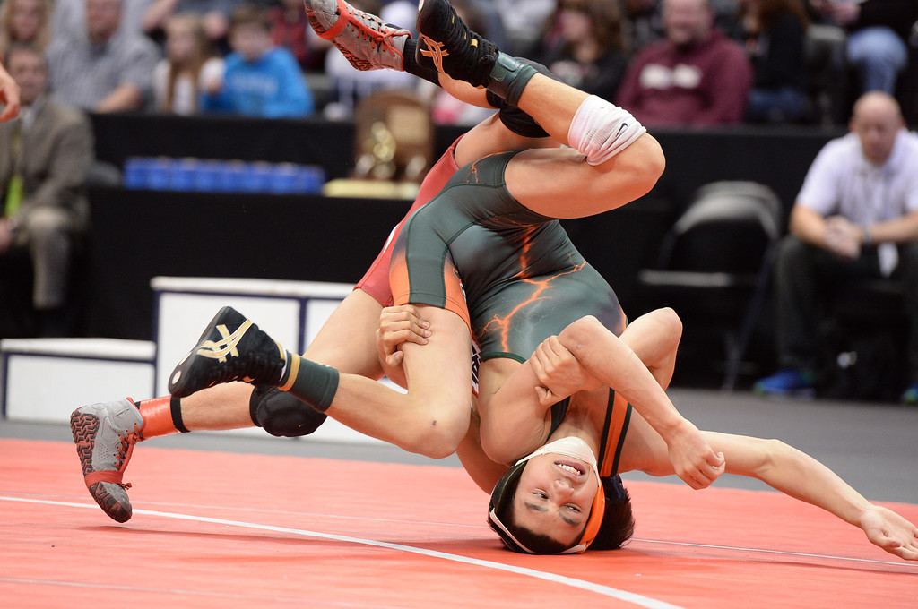 . DENVER, CO - FEBRUARY 22: Tomas Gutierrez of Pomona (in red) wrestles Fabian Gutierrez (in green) of Adams City in the 5A 106lb. championship match. The Colorado Wrestling Tournament was held at the Pepsi Center in Denver, Colo. on February 22, 2014. (Photo by Karl Gehring/The Denver Post)