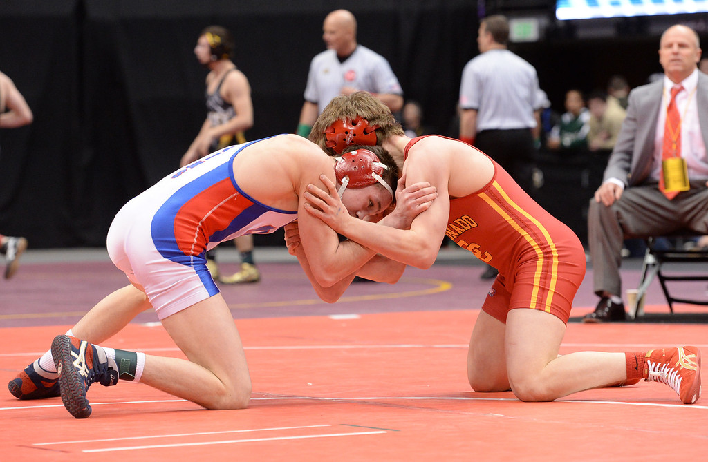 . DENVER, CO - FEBRUARY 22: Mitch Finesilver of Cherry Creek (in white) wrestles Jess Hankin of Coronado (in red) in the 5A 126lb. championship match. The Colorado Wrestling Tournament was held at the Pepsi Center in Denver, Colo. on February 22, 2014. (Photo by Karl Gehring/The Denver Post)