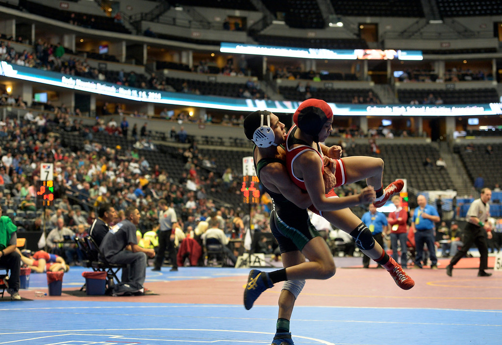 . DENVER, CO - FEBRUARY 21: Denver East\'s Maya Nelson competes in the 5A 120 pound class against Juan Rodriguez from Pine Creek. The Colorado Wresting State Championships take place at the Pepsi Center with the quarterfinals taking place on Friday, Feb. 21, 2014. (Photo by Kathryn Scott Osler/The Denver Post)