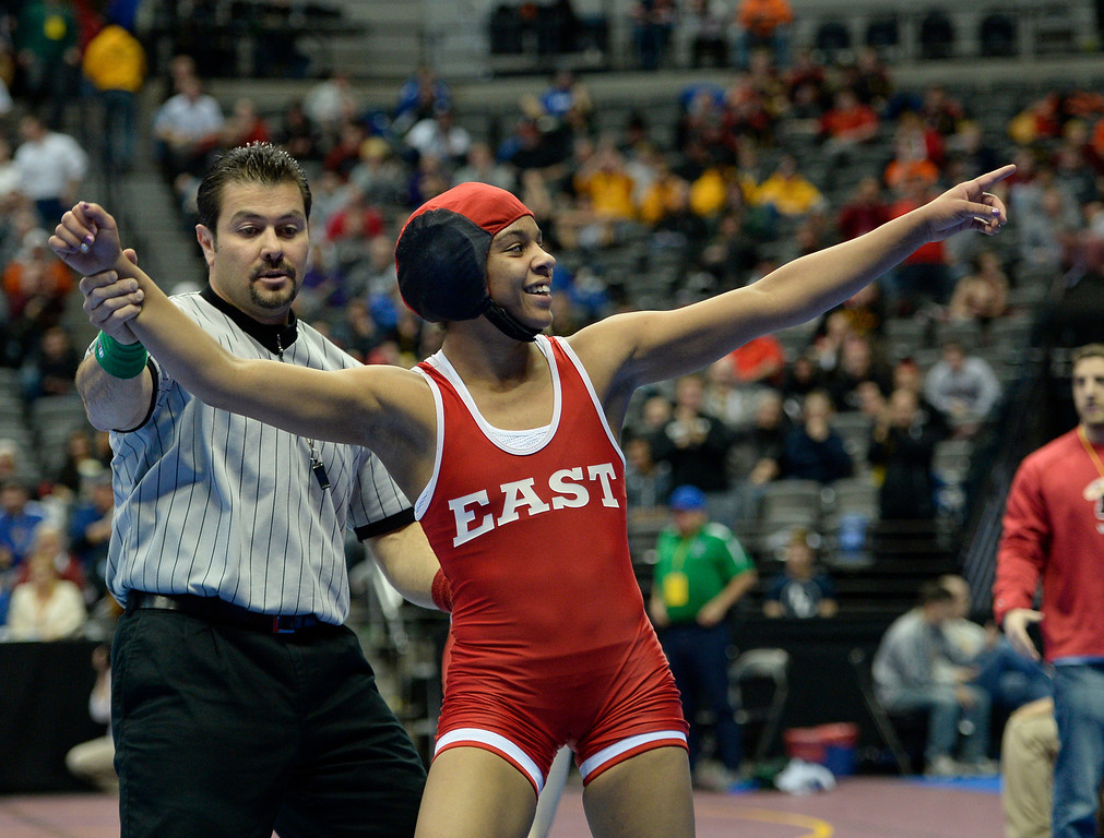 . DENVER, CO - FEBRUARY 20: Maya Nelson of Denver East points to family and friends in the stands after her 13-9 win over Carl Camposanto of Regis during their 5A 106 pound match on the first day of Colorado High School State Wrestling February 20, 2014 Pepsi Center. (Photo by John Leyba/The Denver Post)