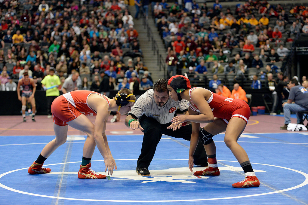 . DENVER, CO - FEBRUARY 20: Carl Camposamnto of Regis takes on Maya Nelson of Denver East during their %A 106 pound match on the first day of Colorado High School State Wrestling February 20, 2014 Pepsi Center. Finesilver defeated Berry (Photo by John Leyba/The Denver Post)