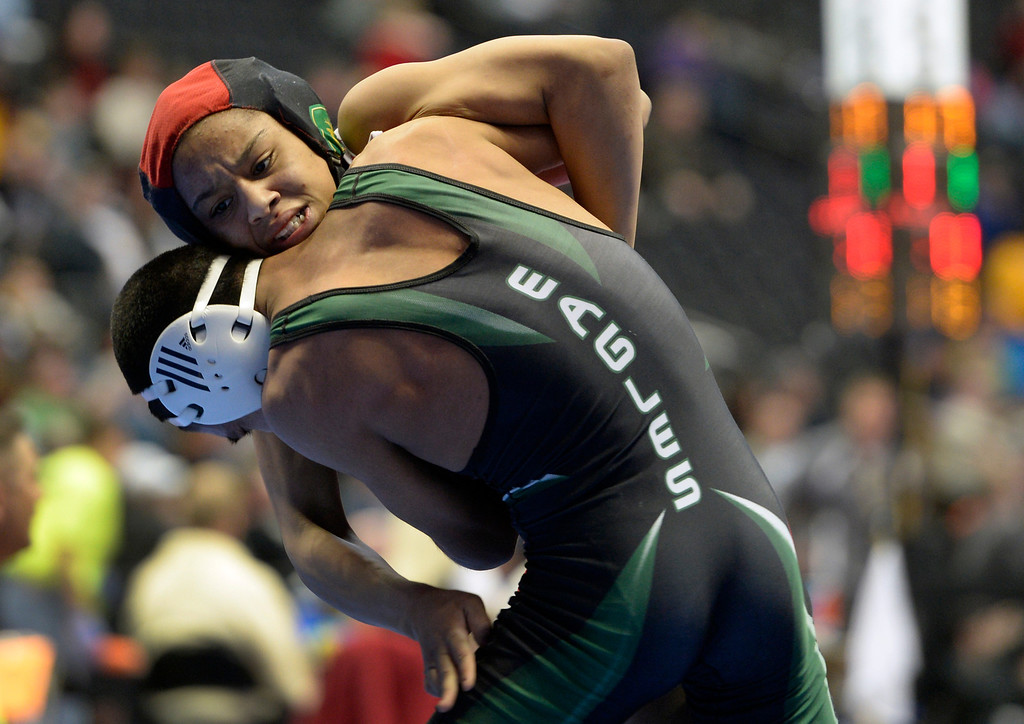 . DENVER, CO - FEBRUARY 21: Denver East\'s Maya Nelson competes in the 5A 120 pound class against Juan Rodriguez from Pine Creek.The Colorado Wresting State Championships take place at the Pepsi Center with the quarterfinals taking place on Friday, Feb. 21, 2014. (Photo by Kathryn Scott Osler/The Denver Post)