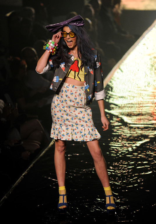 """. DENVER, CO. - APRIL 11:  Models hit the watery runway with creations from Denver designer Mondo Guerra and his \""""Haute Dog\"""" collection Thursday night. Denver Fashion Weekend kicked off with a runway show at City Hall Amphitheater Thursday night, April 11, 2013 with works from Piazza, 50, Covello, Incroyables, Rachel Hurst, Fallene Wells, and Mondo Guerra. Photo By Karl Gehring/The Denver Post)"""