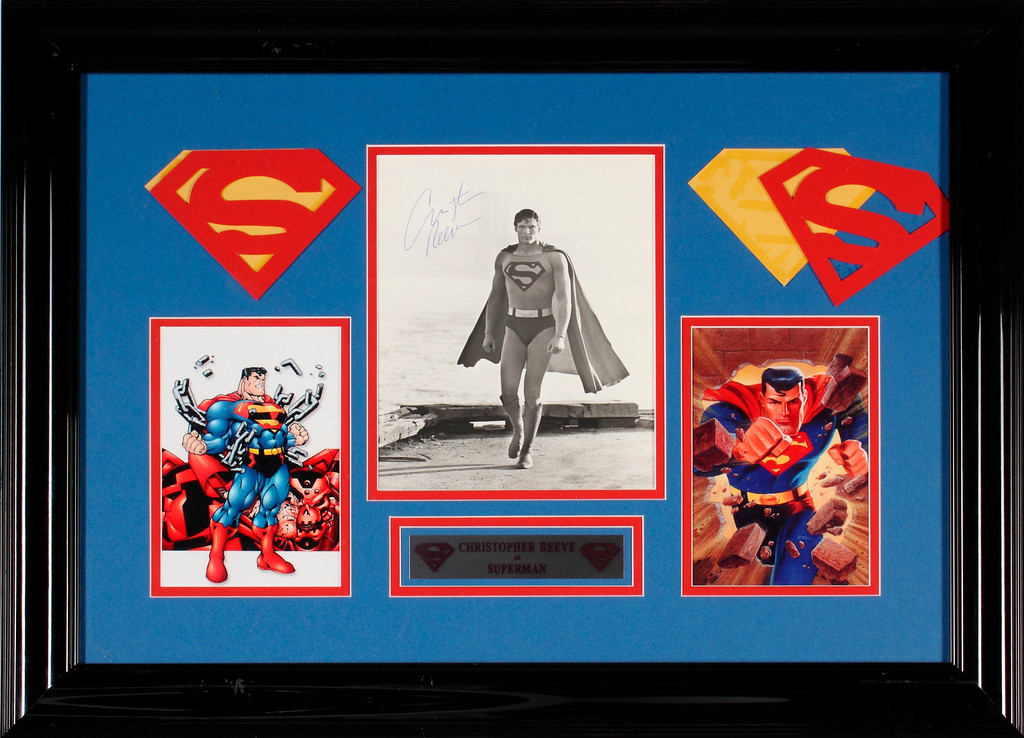 . This photo released by Julien\'s Auctions shows an elaborately framed black and white, eight by ten photograph of Christopher Reeve as Superman, signed in blue pen and framed together with cartoon images of Superman.Estimate: $200 - $300. (AP Photo/Julien\'s Auctions, Shaan Kokin)