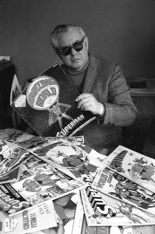 . Joe Shuster poses with numerous comic books of Superman, the cartoon character he and writer Jerry Siegel created in 1933, in New York, on November 18, 1975.  (AP Photo)