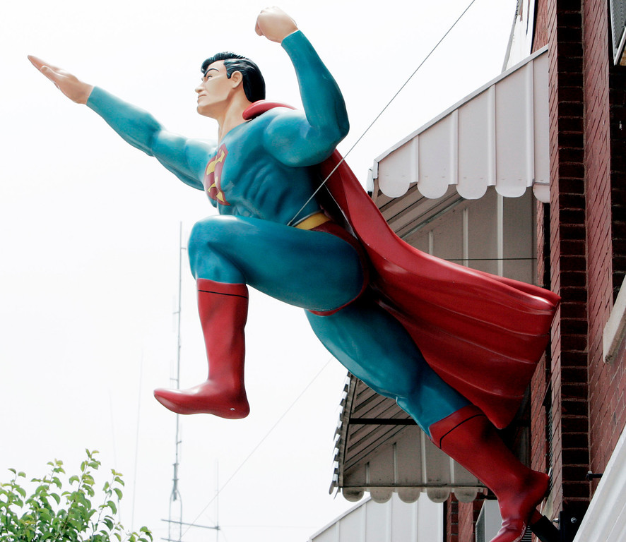 ". A life-size statue of Superman appears to be taking flight from the second floor of the Superman Museum in Metropolis, Ill., Thursday, June 9, 2005. Metropolis is the adopted home of Superman and is seeing an increase in tourists as a result of the  movie ""Superman Returns,\"" which opened Wednesday, June 28, 2006, in U.S. theaters. (AP Photo/James A. Finley)"
