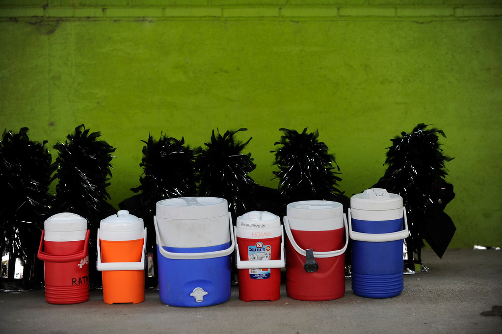 . DENVER, CO. - JULY 6:  Large coolers of water stood at the ready Saturday as musicians warmed up outside the stadium. The nation\'s top drum and bugle corps entertained a crowd and battled for top honors at the Drums Along the Rockies competition at Sports Authority Field Saturday July 6, 2013. Photo By Karl Gehring/The Denver Post