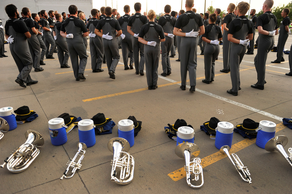 . DENVER, CO. - JULY 6:  Members of the Troopers Drum and Bugle Corp from Caspar, WY warmed up outside the stadium Saturday night. The nation\'s top drum and bugle corps entertained a crowd and battled for top honors at the Drums Along the Rockies competition at Sports Authority Field Saturday July 6, 2013. Photo By Karl Gehring/The Denver Post