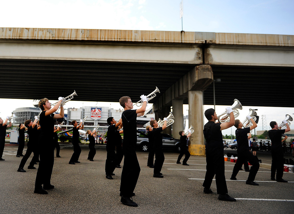 . DENVER, CO. - JULY 6:  Members of the Spokane Thunder Drum and Bugle Corps picked up their instruments to warm below the Colfax Avenue viaduct before competition Saturday. The nation\'s top drum and bugle corps entertained a crowd and battled for top honors at the Drums Along the Rockies competition at Sports Authority Field Saturday July 6, 2013. Photo By Karl Gehring/The Denver Post