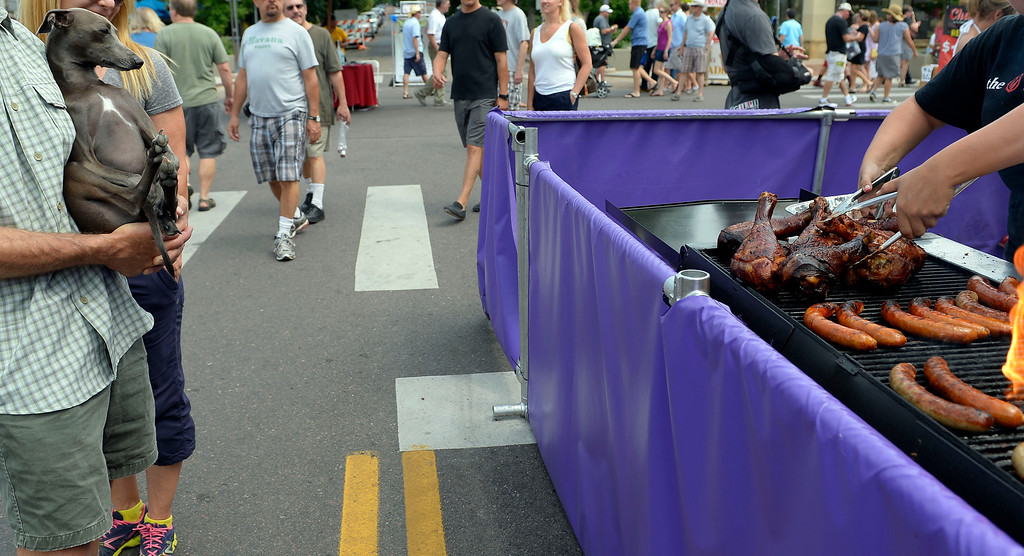 . A dog checks out the goods on the grill at the Cherry Creek Arts Festival June 7, 2013 in Cherry Creek North. The festival has been going on for three days during the July 4th holiday weekend since 1991, Colorado\'s signature cultural event. (Photo By John Leyba/The Denver Post)
