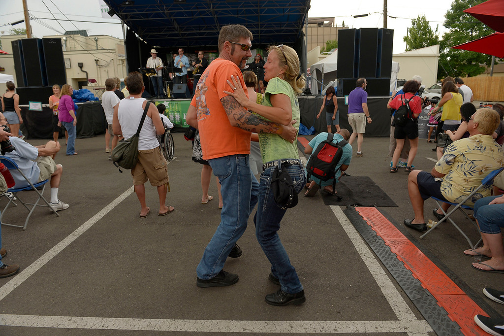 . Ken Rouff and Sue Christenson dance to the tunes of Thumpin at the Cherry Creek Arts Festival June 7, 2013 in Cherry Creek North. The festival has been going on for three days during the July 4th holiday weekend since 1991, Colorado\'s signature cultural event. (Photo By John Leyba/The Denver Post)