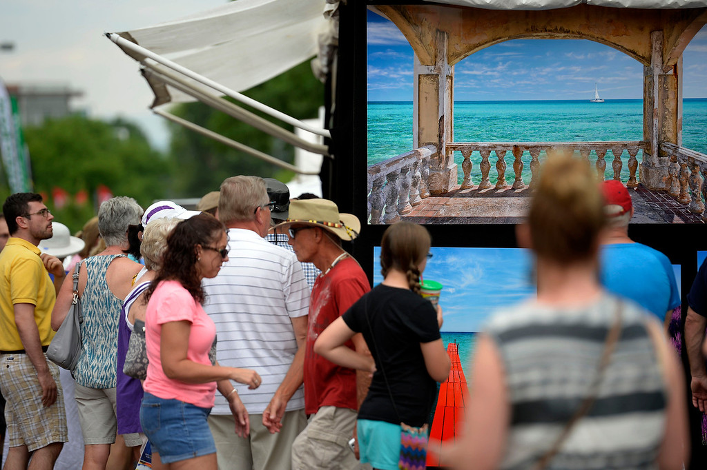 . Patrons take in the day as they check out art work at the Cherry Creek Arts Festival June 7, 2013 in Cherry Creek North. The festival has been going on for three days during the July 4th holiday weekend since 1991, Colorado\'s signature cultural event. (Photo By John Leyba/The Denver Post)