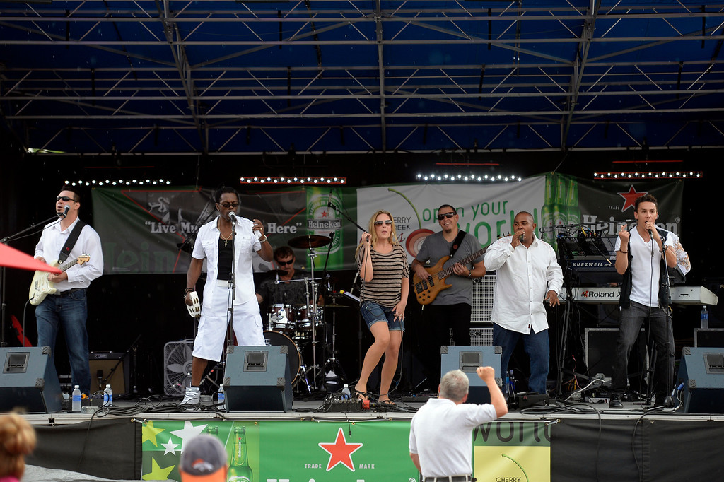 . Soul X pumps out the jams on the main stage at the Cherry Creek Arts Festival June 7, 2013 in Cherry Creek North. The festival has been going on for three days during the July 4th holiday weekend since 1991, Colorado\'s signature cultural event. (Photo By John Leyba/The Denver Post)