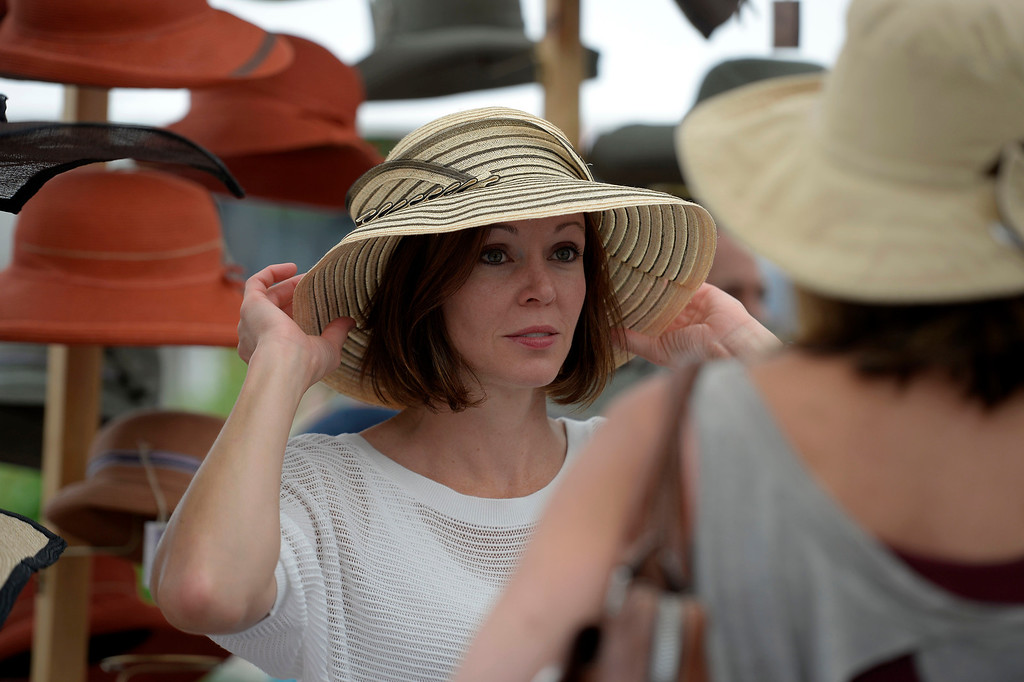 . Ginger Oliver 36, tries on a hat made by Diana Hart of Frisco at the Cherry Creek Arts Festival June 7, 2013 in Cherry Creek North. The festival has been going on for three days during the July 4th holiday weekend since 1991, Colorado\'s signature cultural event. (Photo By John Leyba/The Denver Post)