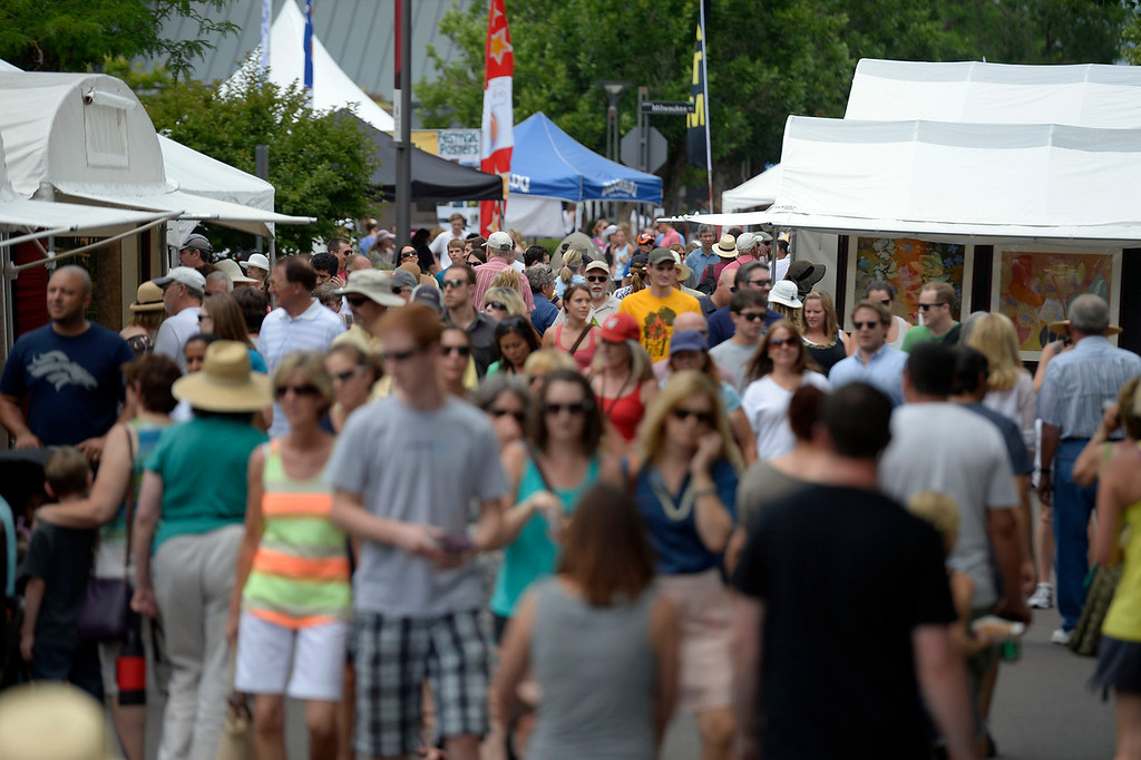 . Patrons take in the day at the Cherry Creek Arts Festival June 7, 2013 in Cherry Creek North. The festival has been going on for three days during the July 4th holiday weekend since 1991, Colorado\'s signature cultural event. (Photo By John Leyba/The Denver Post)
