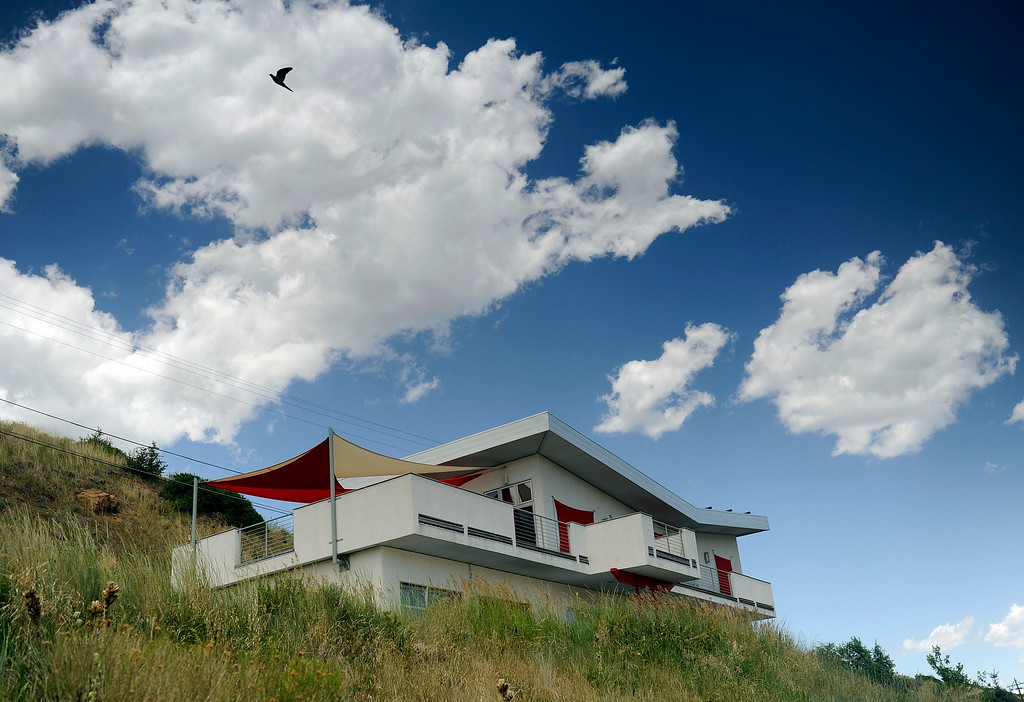 """. The home, known as the \""""Ghost House,\"""" was designed by Workshop8 architect Joseph Vigil and built by Storey Real Estate & Construction, and built on Green Mountain in Lakewood, Colorado. (Photo By Cyrus McCrimmon/The Denver Post)"""