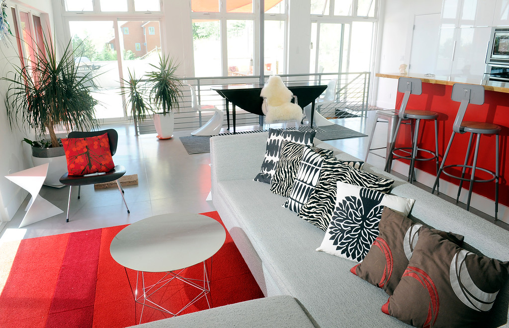 . Brandy LeMae\'s design for the living room pops with brights and prints. (Photo By Cyrus McCrimmon/The Denver Post)