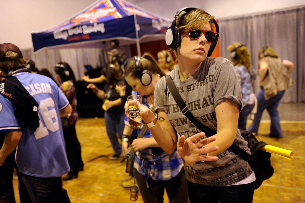 . DENVER, CO. - OCTOBER 12: Gabrielle Kulesza hit the dance floor with friends at the Oskar Blue Brewery sponsored Silent Disco party at the Great American Beer Festival Saturday. Only those wearing headphones could hear the music. Thousand of beer fans flocked to the Great American Beer Fest at the Colorado Convention Center Saturday afternoon, October 12, 2013. Photo By Karl Gehring/The Denver Post
