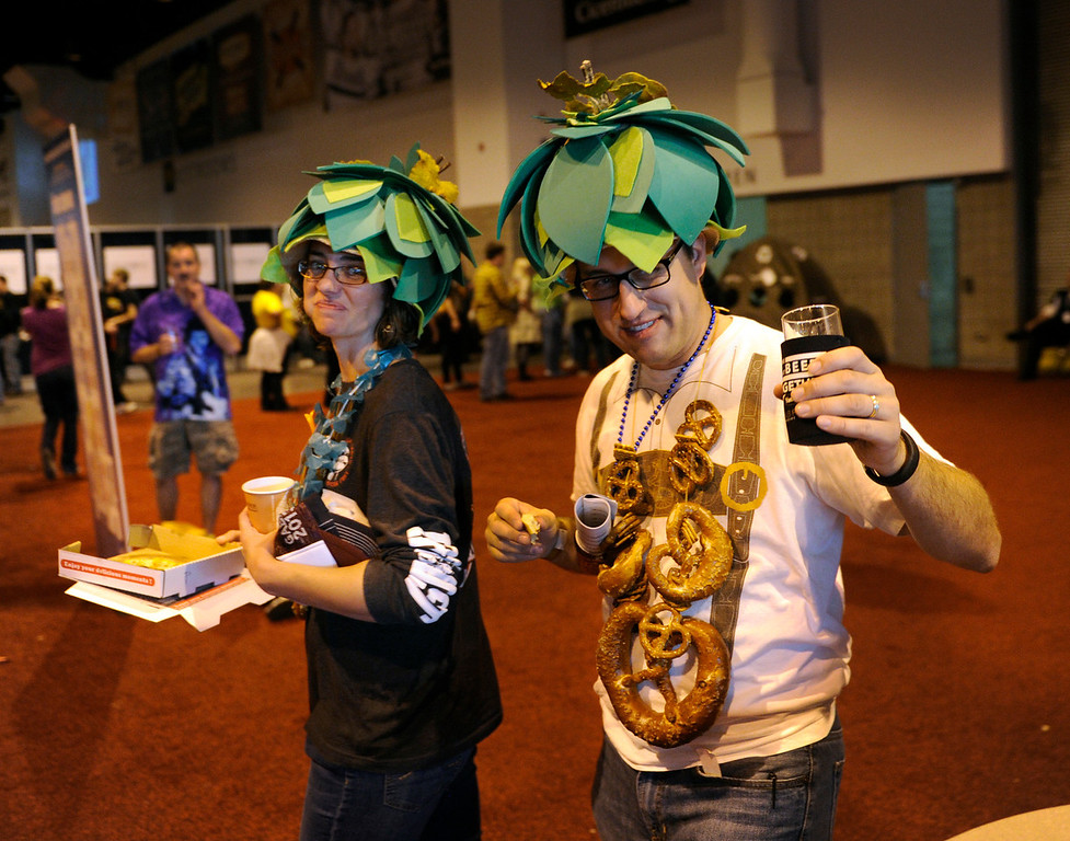 . DENVER, CO. - OCTOBER 12: Joylyn Trickel and her husband Matt modeled hops hats she made in honor of the Great American Beer Festival. Thousands of beer fans flocked to the Great American Beer Festival at the Colorado Convention Center Saturday afternoon, October 12, 2013. Photo By Karl Gehring/The Denver Post